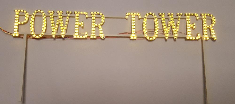 Enseigne power tower illuminée